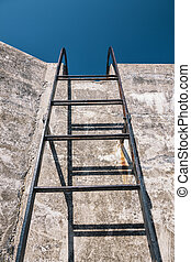 Concrete wall and ladder - Metal ladder looking up towards...