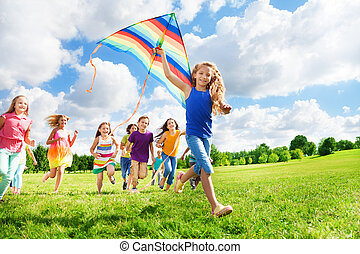 Cool girl with kite and her friends