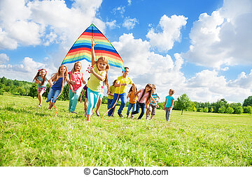 Little girl with friends and kite