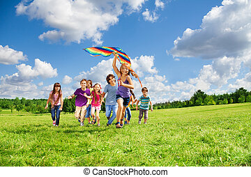 Many kids have fun with kite - Cute happy active kids boys...