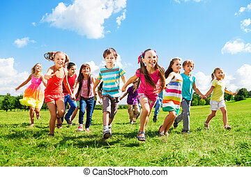 Kids running enjoying summer - Many different kids, boys and...