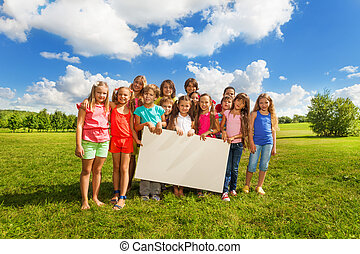 Kids with board for copy space