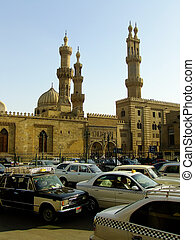 Street of Islamic district with traffic, Cairo, Egypt