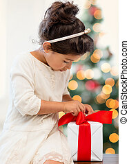 happy child girl with gift box - holidays, presents,...