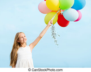 happy girl with colorful balloons - summer holidays,...