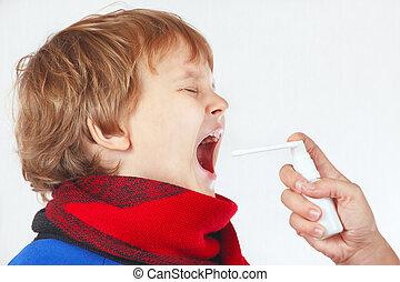 Little sick boy used medical aerosol for breath on white...