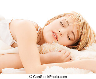 teenage girl sleeping at home - health and beauty concept -...