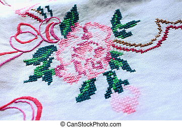 Embroidered table-cloth - A table-cloth with embroidered...