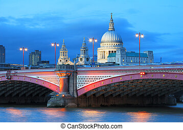 Saint Paul's Cathedral with evening lights and sky