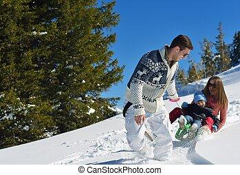 family having fun on fresh snow at winter - Winter season....