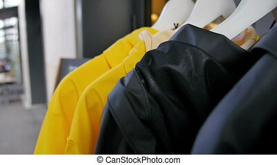 Raincoats on rack outside shop - HD 1080p - A set of rain...