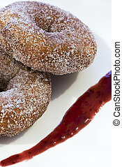 Donuts - A pair of cinnamon donuts garnished with rasberry...