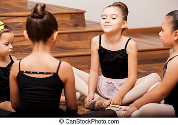 Girls warming up in dance class - Pretty little Latin girls...