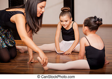 Dance students and teacher in class - Pretty Hispanic little...