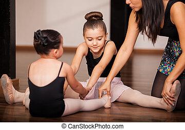 Little girls in a ballet class - Two little girls warming up...