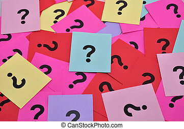 Question marks symbols - Pile of colorful paper notes with...
