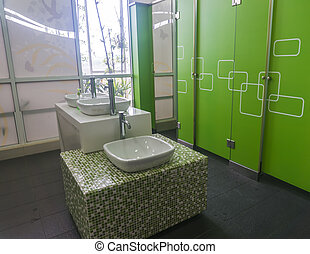 Empty modern restroom interior with washstands