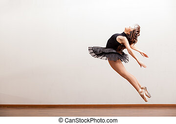 Gorgeous ballerina during a jump - Beautiful ballerina in a...