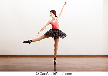 Rehearsing in a dance academy - Gorgeous Hispanic ballerina...