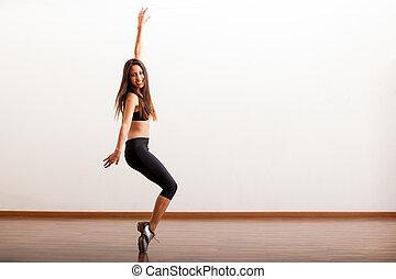 Cute tap dancer having fun - Pretty Latin female dancer...
