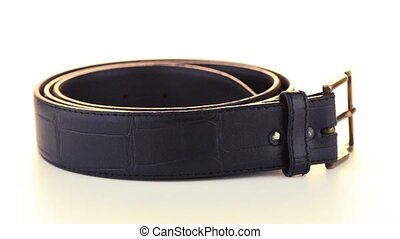 Leather belt rotating on white background