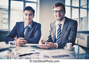 Successful partners - Image of smart young businessmen...
