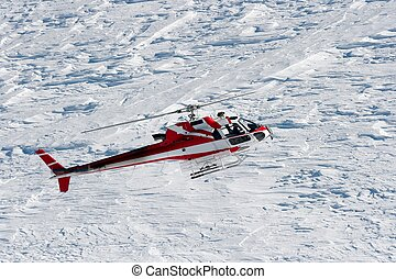 Helicopter - Rescue helicopter flying above snow covered...