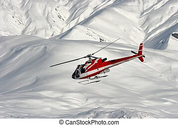 Rescue - Mountain rescue helicopter on a snowy landscape