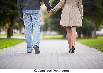Couple walking - Legs of couple walking in park