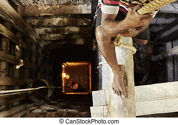 Moonstone mine - Worker climbs down into the moonstone mine...