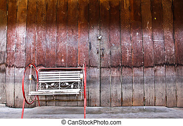 Chinese old building exterior with door and single chair in...