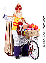 Sinterklaas on a bike, going to bring presents to the...