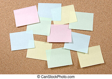 Colorful post-it notes on corkboard
