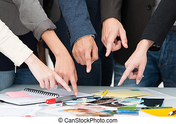 Business team pointing to a universal choice - Cropped view...