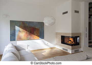 Artists corner - Cosy living room with original painting on...