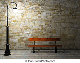 Illuminated brick wall with old street light and bench -...