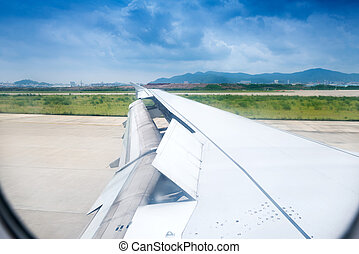 the wing is moving up when airplane is landing to runway