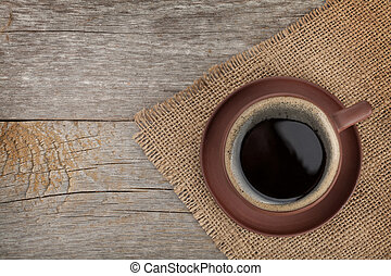 Coffee cup on wooden table texture View from above