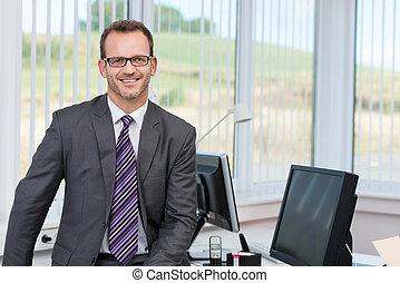 Confident successful male business executive relaxing on the...