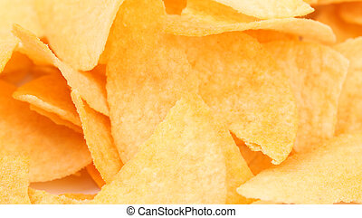 Background of potato chips. Close up. Whole background.