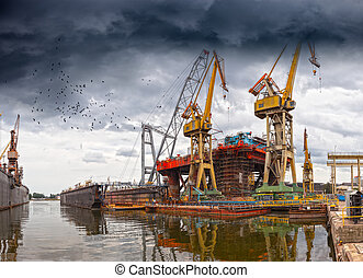 Shipyard Industry - Dramatic scenery of the shipyards in...