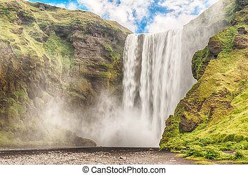 Skogafoss is a well known Icelandic waterfall on the South...