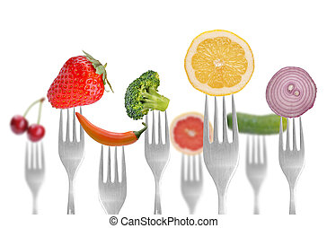 vegetables and fruits on the collection of forks, diet...