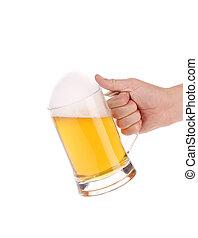 Full beer mug in hand.