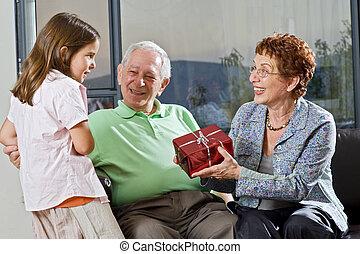grandparents gift grandchild - grandparents giving gift to...