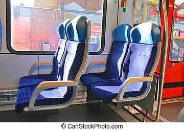 Rows of seats in a passenger train car.