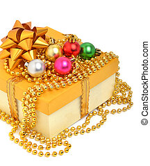 Yellow gift box with christmas baubles and beads isolated on...