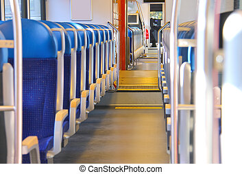 Rows of seats in a passenger train car
