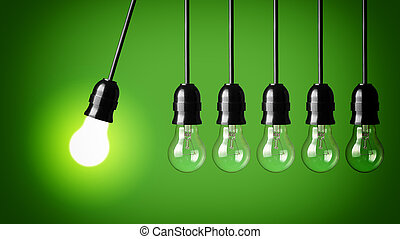 Perpetual motion with light bulbs - Idea concept on green...