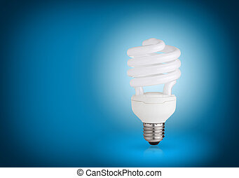 energy saving light bulb on blue background